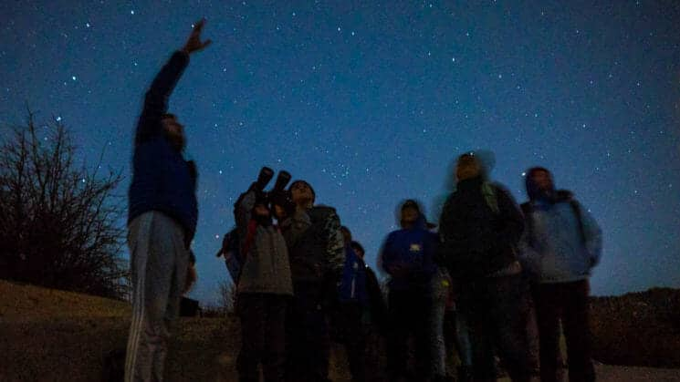 Group looks at night sky during Pali Institute astronomy class