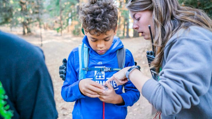 Pali instructor helps student with compass