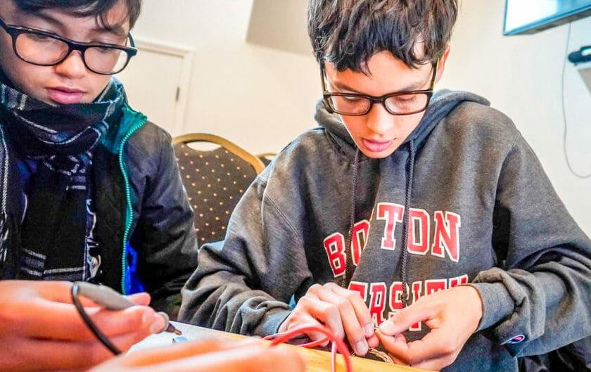 Pali students connect wires in electricity class