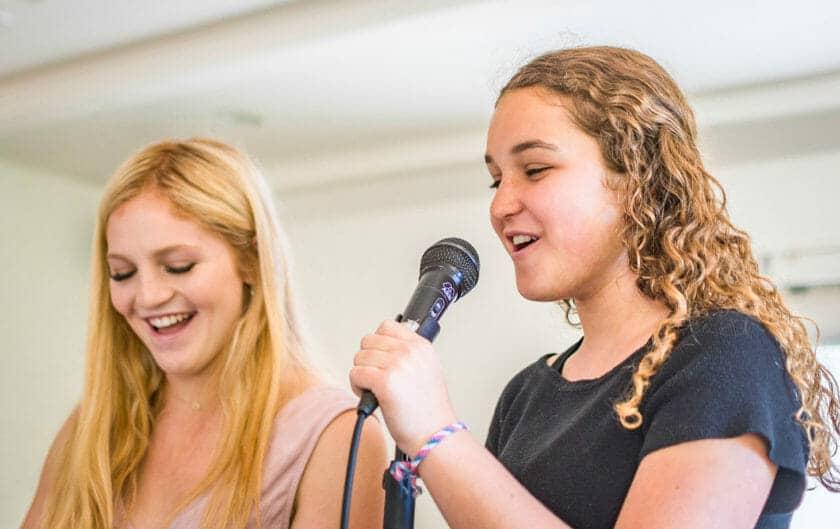 Girls sing karaoke at Pali Institute