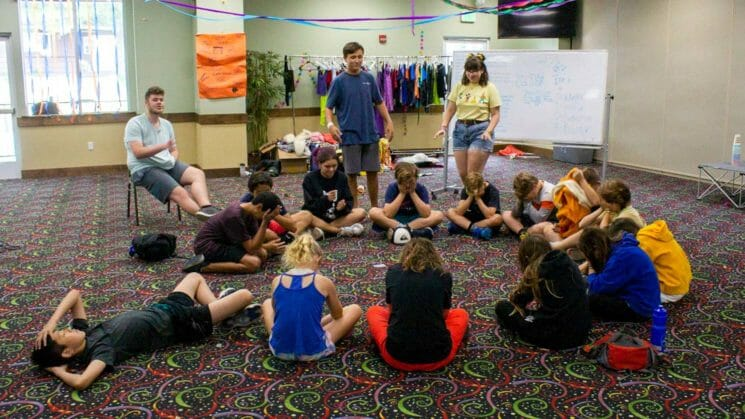 Students gather in floor circle for group activity