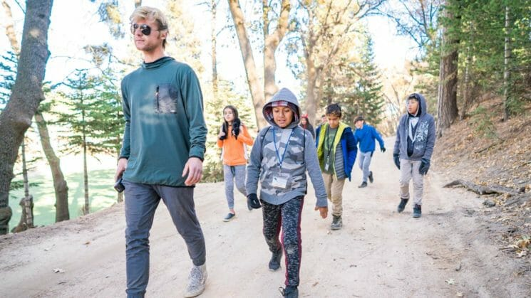 Group of Pali hikers walk down wide trail