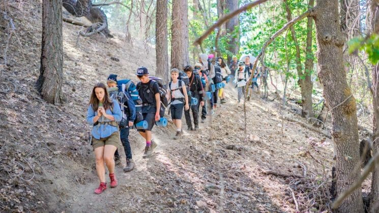 Group of Pali hikers descend trail in a line