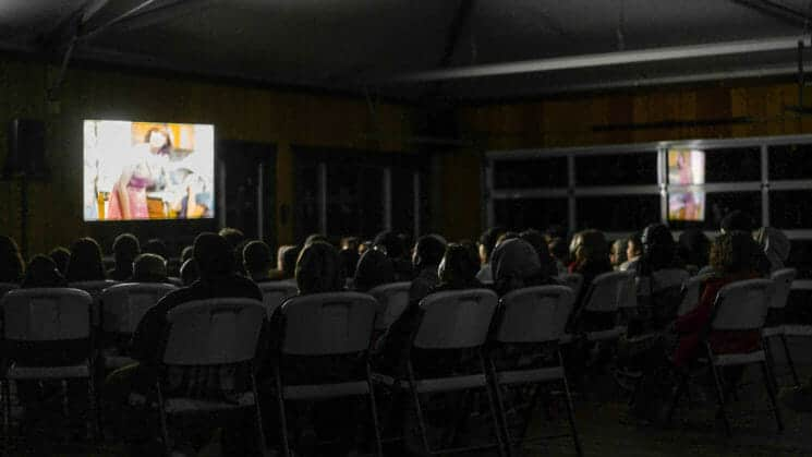 Group of students watch a movie at Pali Institute