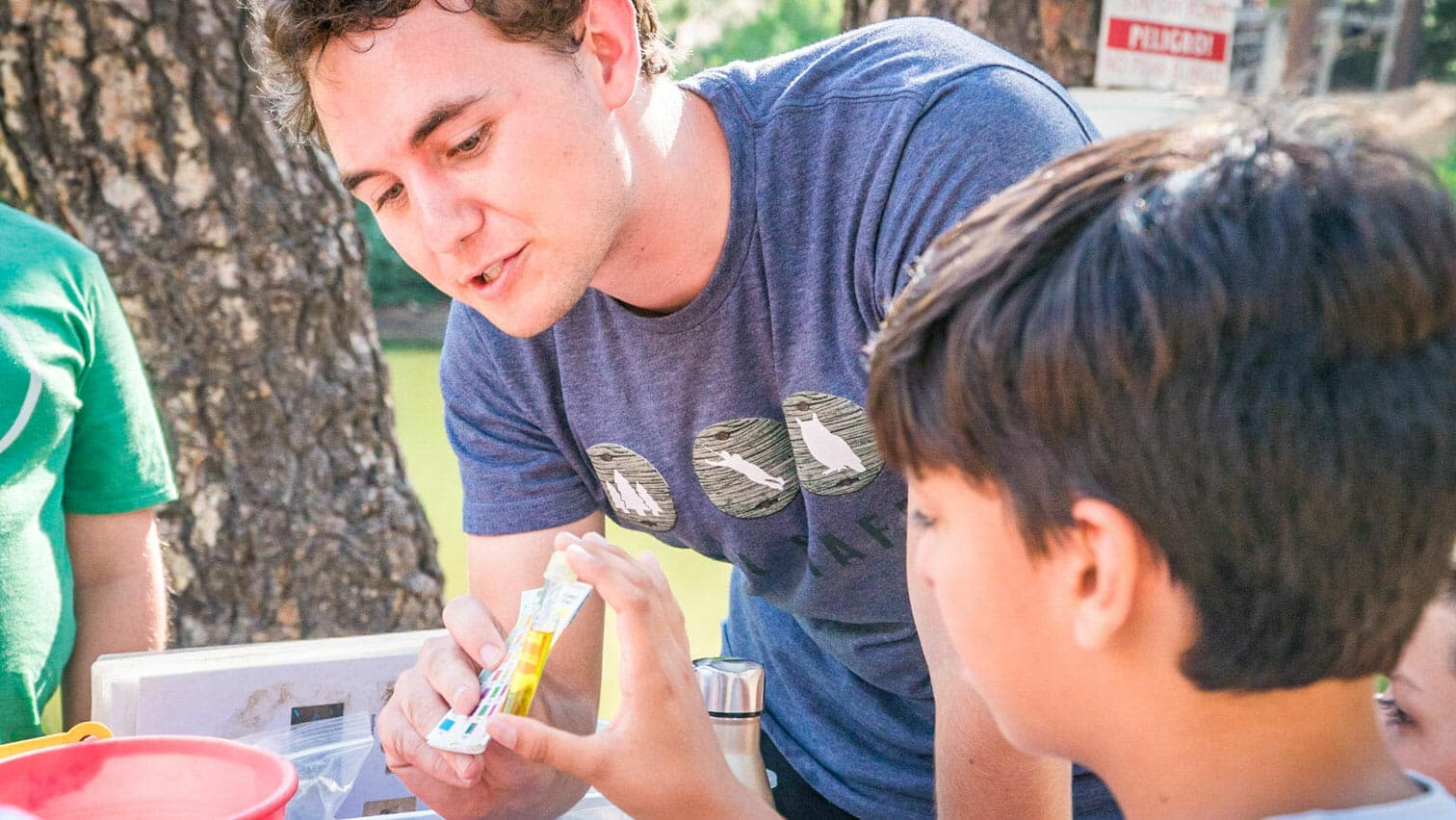 Pali instructor helps student with biology lesson