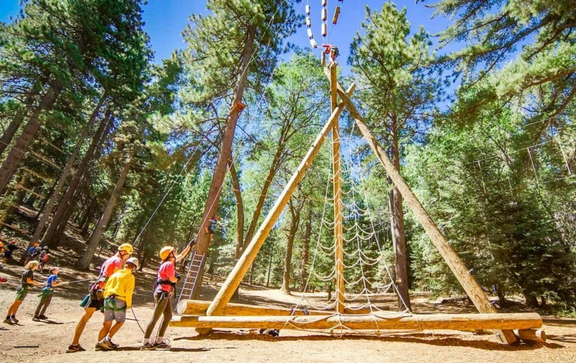 Pali Institute students climb ropes course structure
