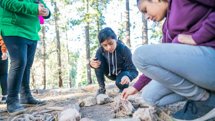Students learn to build fire at Pali Institute